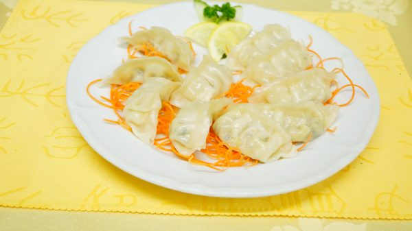 Two folds of steamed & fried dumplings with vegetables
